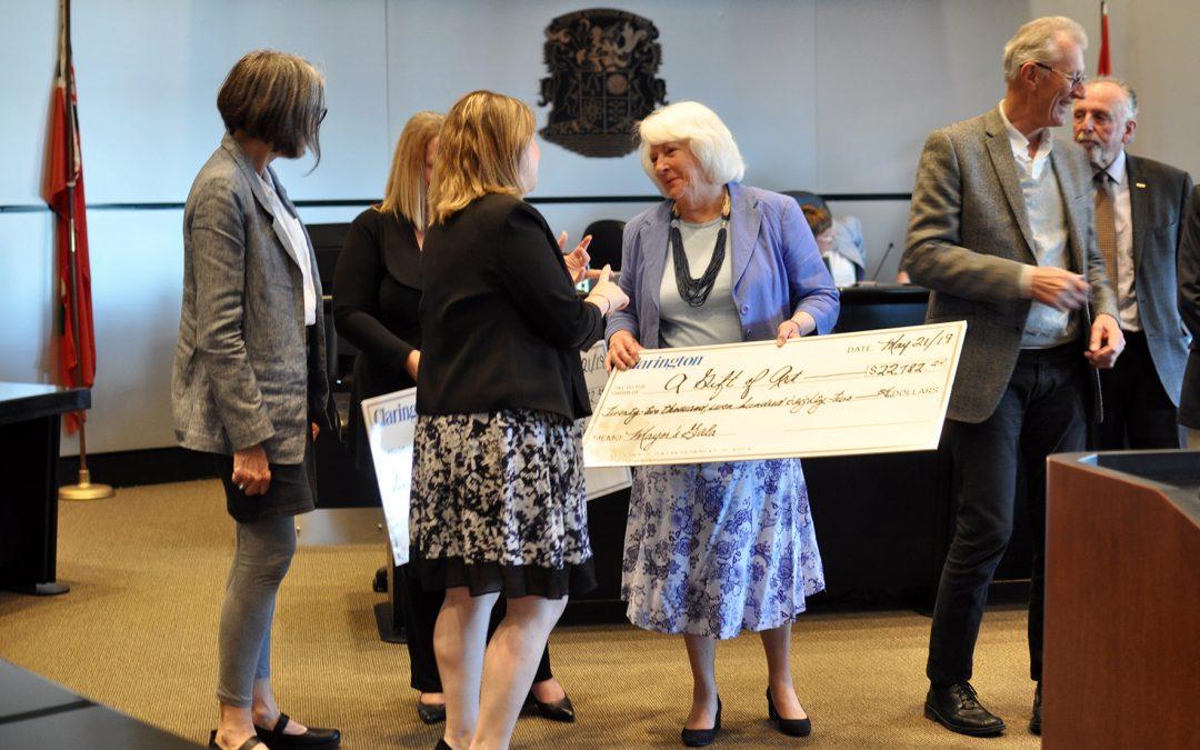 Clarington Council meeting cheque presentation