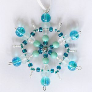 Blue and white beaded snowflake pendant